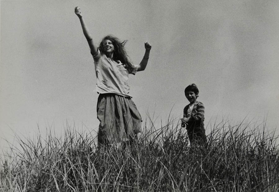 Mary and Pablo in high grass circa 1956 by Robert Frank born 1924